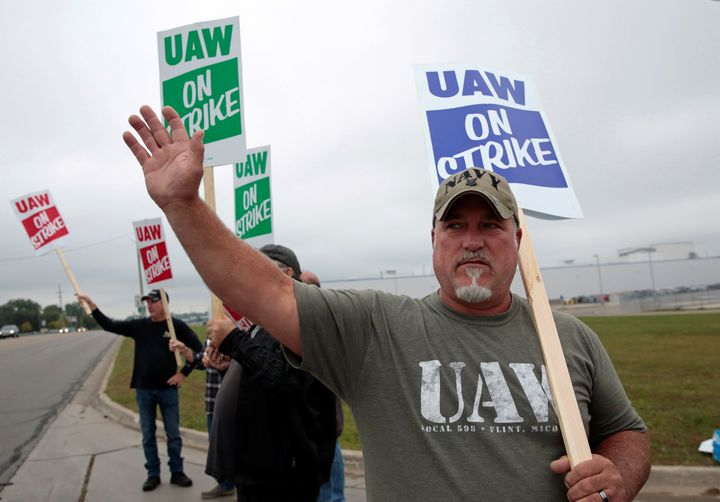 General Motors assembly worker Scott Gribson pickets outside the General Motors Powertrain Flint Engine plant during the nati