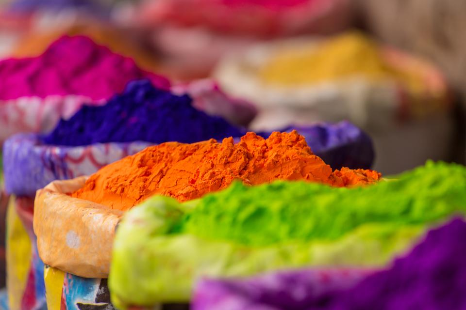 Colorful piles of powdered dyes used for Holi festival