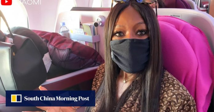 Disease precautions on a plane? Supermodel ahead of the game