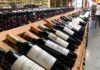 Break out the tumblers. The price of wine is dropping fast