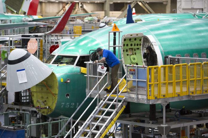 Boeing halts hiring, limits overtime as coronavirus poses 'global economic disruption', shares down 13%
