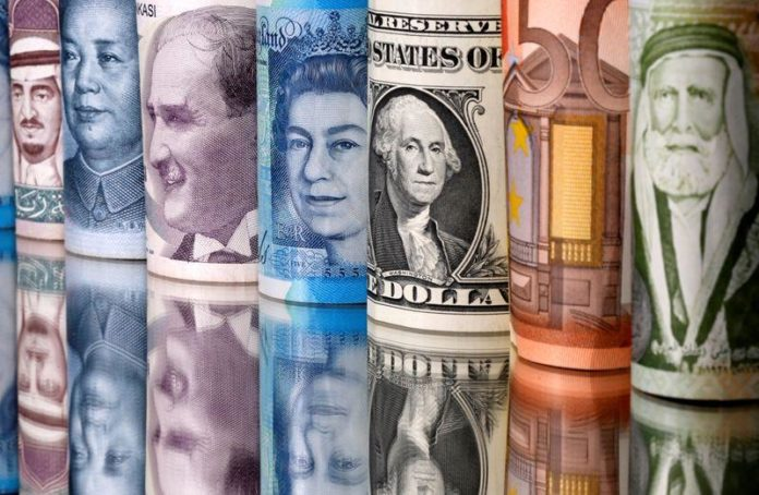 FOREX-Dollar shines as pandemic drives rush for liquid assets