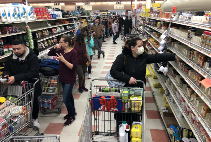 Grocers limit food purchases, urge shoppers not to hoard as panic buying continues. Kroger ramps up hiring