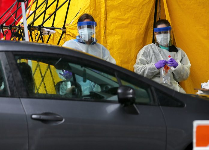 As demand for coronavirus testing grows, Walmart and Walgreens will soon open drive-through sites for first responders