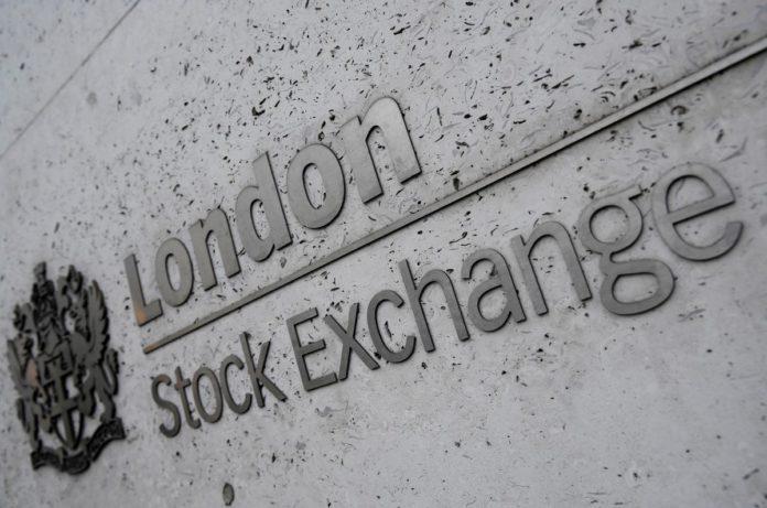 Dollar up, Asian stocks slip as U.S. pins blame for virus on China