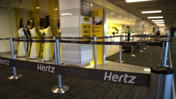Hertz's stock gives back more than half of the postbankruptcy surge after NYSE delisting notice