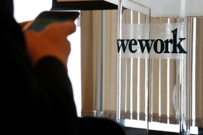 WeWork chairman says positive cash flow due in 2021, a year ahead of schedule