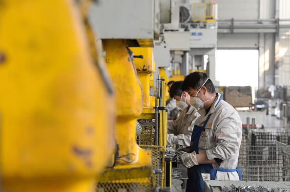 China says manufacturing activity expanded in August, slightly missing expectations