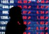 Asian shares on firm footing as vaccine trials resume