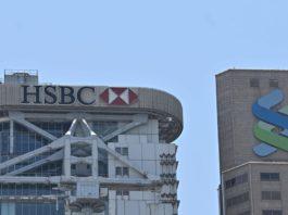 European bank stocks slide after money-laundering allegations; Dow futures slide 300 points